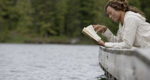 Even when relaxing, people feel an urge to read something 'improving' or useful. Photograph: Noel Hendrickson/Thinkstock/Getty