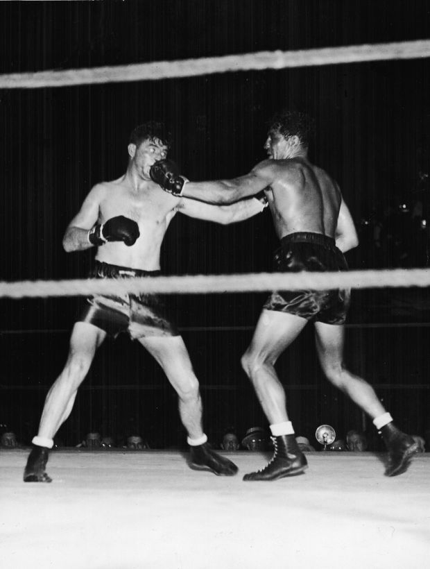 James Braddock and Max Baer trade blows during a title bout in Long Island City, New York in 1935. Braddock went on to win the title after 15 rounds. Photograph: FPG/Getty Images