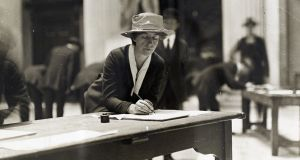 Trade unionist Delia Larkin signing the Anti-Conscription Pledge at City Hall, April 1918. Photograph: National Library