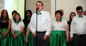 Prosper Player Stephen Dowdall leads performers from Prosper Fingal's service in Rush and students from St Joseph's Secondary School at a gala evening celebrating 40 years of Prosper Fingal in the Roganstown Hotel and Country Club, Swords, Co Dublin. Photograph: Fintan Clarke
