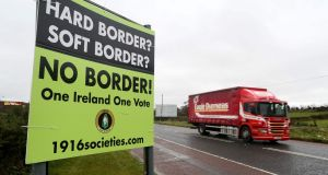 A lorry passes a sign  near the Border. The backstop deal ensuring a frictionless border is jeopardising by a no-deal Brexit. Photograph: Paul Faith/Getty Images