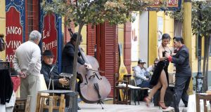 A tango show on the street in Buenos Aires in front of a restaurant with live music.   Photograph: Getty Images