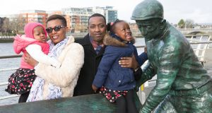 Adolphe Ndagijimana, his wife, Joy, and their two daughters, Jaissah (18 months) and Janice (3). Photograph: Liam Burke/Press 22