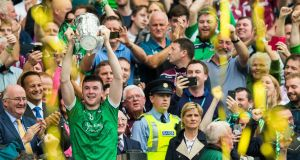 Limerick's Declan Hannon lifts the Liam MacCarthy. Photo: Tommy Dickson/Inpho