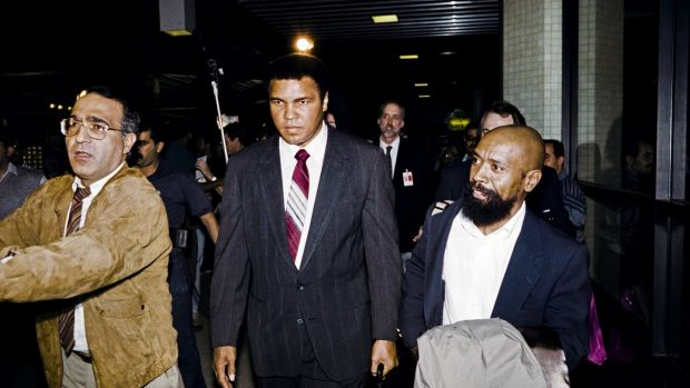 Former heavyweight world boxing champion Muhammad Ali (2nd L) is flanked by unidentified American hostages on December 2nd, 1990 at Amman International airport after their arrival from Baghdad. Ali was instrumental in the release of 15 US hostages held captive in Iraq. Photo: Rabih Moghrabi/AFP/Getty Images