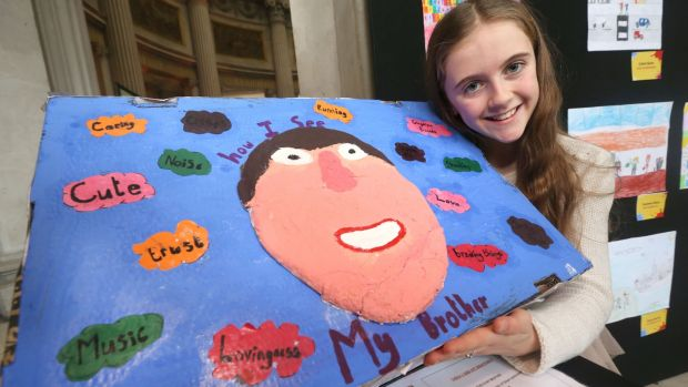 Maeve Allen from Ballinderry NS, Co Galway with artwork dedicated to her brother Liam, was a finalist in the 'Someone Like Me' national art competition. Photograph: Finbarr O'Rourke