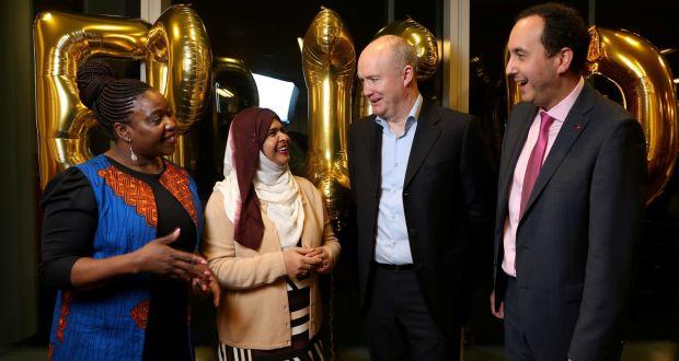 Winifred Akinyemi  and Afifa Rahman, EPIC scheme graduates,  with Virgin Media CEO Tony Hanway and BITC chief executive Tomás Sercovich. Photograph: Jason Clarke