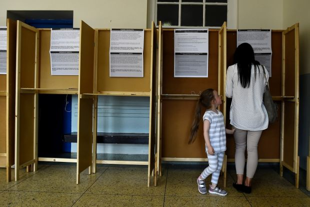 A woman casts her vote with her daughter in a polling station on the day of the abortion referendum in Dublin on May 25th, 2018. Photograph: Clodagh Kilcoyne/Reuters