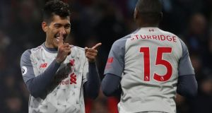 Liverpool's Roberto Firmino celebrates scoring their second goal with Daniel Sturridge during the 3-1 Premier League win over Burnley. Photo: Scott Heppell/Reuters