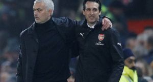 Manchester United manager Jose Mourinho with Arsenal manager Unai Emery after the final whistle at Old Trafford. Photograph: Reuters