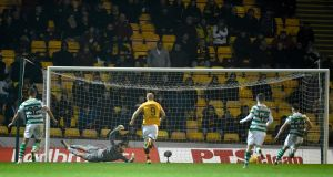 Motherwell's Danny Johnson scores against Celtic at Fir Park. Photograph: PA