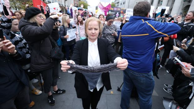 Solidarity People Before Profit TD Ruth Coppinger holds a thong during a protest in support of victims of sexual violence on O'Connell Street in November. Photograph: Niall Carson/PA Wire
