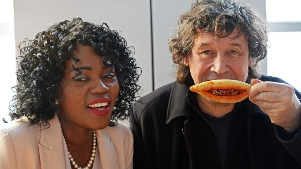 Ellie Kisyombe, founder of Our Table, a pop-up cafe aimed at highlighting the need to end Direct Provision, with the actor Stephen Rea. Photograph: Eric Luke / The Irish Times