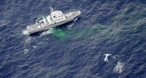 A Japan Coast Guard patrol vessel searches  the area where two US  Marine Corps aircraft crashed off the coast of Kochi prefecture, Japan; Photograph: Kyodo/Reuters