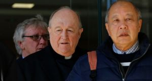 Former  Archbishop of Adelaide Philip Wilson (C) leaves court in Newcastle, New South Wales, following a hearing in August. Photograph: Darren Pateman/EPA