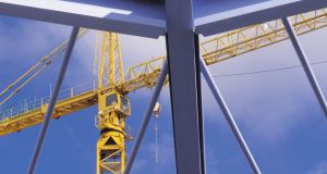 Construction crane and steel girders