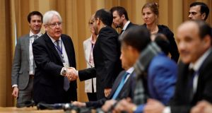 UN envoy to Yemen Martin Griffiths greets Yemeni delegates at the opening press conference on UN-sponsored peace talks for Yemen in Rimbo, Sweden. Photograph: Stina Stjernkvist /TT News Agency/via Reuters