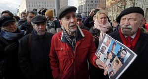 "Russian human rights activist Lev Ponomaryov (centre) taking part in the ""For Our and Your Children"" rally in Moscow on October 28th. Photograph: Yuri Kochetkov/EPA"