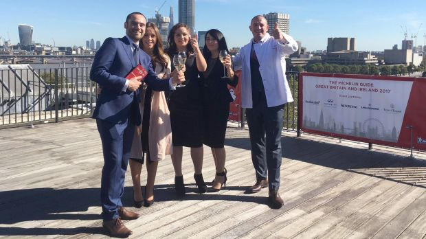 Andrew Heron and Damien Grey with their wives Claudia and Jessica and chef Roisin Gillen celebrating being awarded a Michelin star in 2016.