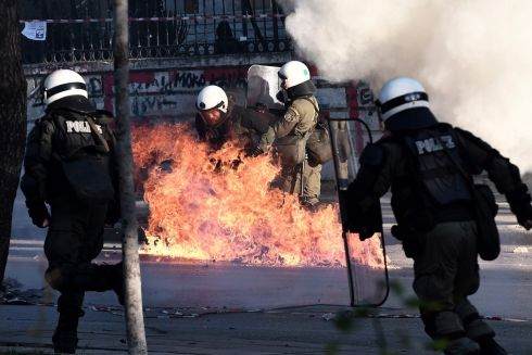 FLAME: Petrol bombs explode next to riot police officers during a demonstration in Athens on December 6th to commemorate the 10th anniversary of fatal shooting of a teenager which sparked major riots in Greece in 2008. Photograph: Sakis Mitrolidis/AFP/Getty