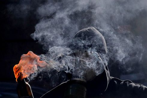 INCOMING: A protester prepares to hurl a Molotov cocktail during clashes with riot police after a rally marking the 10th anniversary of the killing of teenager Alexis Grigoropoulos by a Greek police officer, in Thessaloniki, northern Greece on December 6th. Grigoropoulos, a 15-year-old student, was killed on December 6th, 2008 in an alleged police shooting, sparking rioting in the Greek capital.  Photograph: Sotiris Barbarousis/EPA