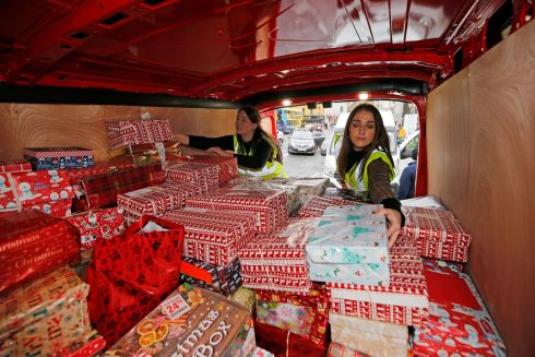BOXED UP: Inner City Helping Homeless Christmas Shoebox appeal at Connolly Station, Dublin.  Laura McCafferty and Grace Jones helping collect the shoebox's.  Photograph Nick Bradshaw/The Irish Times