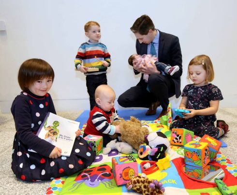 PLAY TIME: Pictured at the launch of mychild.ie, a new HSE pregnancy and child health website and set of three books for parents and parents-to-be, is Minister for Health Simon Harris TD and, from left, Holly McGrath (5) from Baldoyle, Dublin 13, Cormac O'Brien (2) from Saggart, Co Dublin, Cillian McGrath (6 months) and Fiadh Ryan (3) from the Navan Road, Dublin 7. Photograph: Mark Stedman