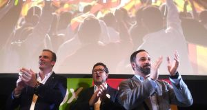 General Secretary of right-wing party Vox, Javier Ortega (left), Andalusia presidential candidate Francisco Serrano  and Vox's President Santiago Abascal wave to supporters after the Andalusian regional election. EPA/Rafa Alcaide