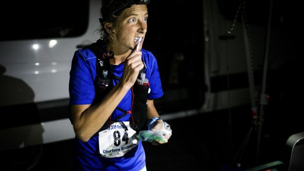 Courtney Dewaulter brushes her teeth at the Spooner Summit, Nevada, aid station at Mile 82 of the Tahoe 200 ultramarathon.