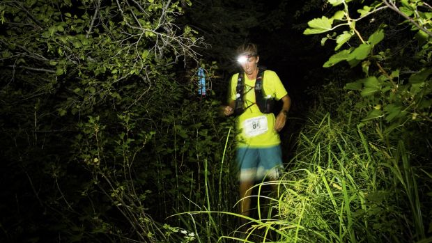 Courtney Dewaulter races through the night about 60 miles into the Tahoe 200 ultramarathon in Incline Village, Nevada.