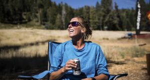 Courtney Dauwalter drinks a beer after the Tahoe 200 ultramarathon. Photograph: Max Whittaker/The New York Times
