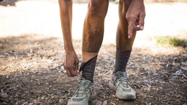 "Courtney Dauwalter shows of her ""dirt-tan"" line after finishing second in the Tahoe 200 ultramarathon."