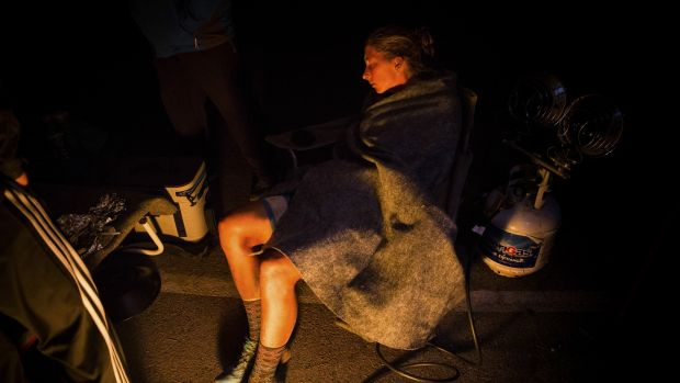 At 3.45 am, Courtney Dauwalter sleeps for a couple of minutes at the Loon Lake, California, aid station at mile 182 of the Tahoe 200 ultramarathon.