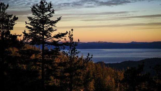 Lake Tahoe at sunrise from mile 104 of the Tahoe 200 ultramarathon in South Lake Tahoe, Nevada. Photograph: Max Whittaker/The New York Times