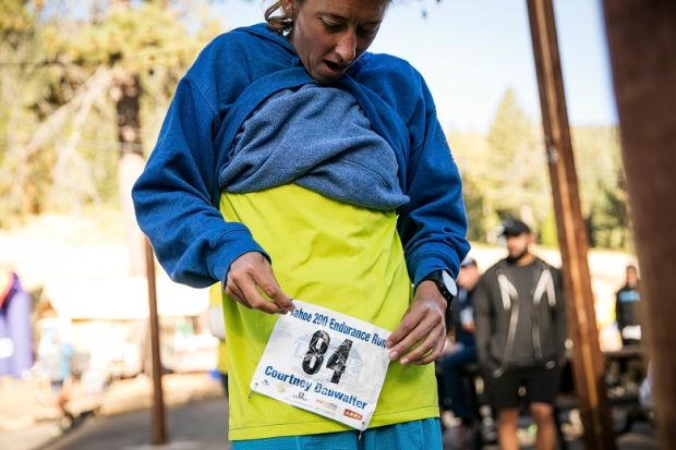 Courtney Dewaulter pins on her number before the start of the Tahoe 200 ultramarathon in Homewood, California on September 7th, 2018. Photograph: Max Whittaker/The New York Times