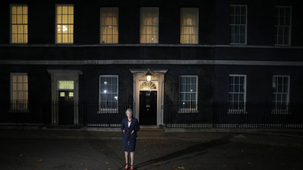 Theresa May outside number 10 Downing Street in London. A number of ministers are urging May to call off Tuesday evening's vote. Photograph: Simon Dawson/Bloomberg via Getty Images