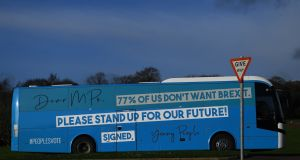 A bus with students from anti-Brexit protest group 'Our Future Our Choice' demonstrates outside  Stormont  in Belfast. Photograph: Clodagh Kilcoyne