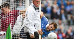 "'Between you and me and the post' – Like sentry guards, Jack McCaffrey and umpire Tom O'Kane watch the ball squirm away from the goal, one of the few moments of danger for Dublin in a relatively straight-forward semi-final win over Galway. Photo: ""A Season of Sundays 2018""/Sportsfile"