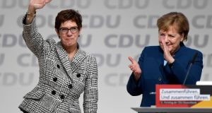 Annegret Kramp-Karrenbauer waves next to German Chancellor Angela Merkel after being elected as the party leader during the Christian Democratic Union (CDU) party congress in Hamburg, Germany, December 7th, 2018. Photograph: Reuters