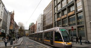 The Luas travelling along Dawson Street, which is undergoing a resurgence. Photograph: Dara Mac Dónaill
