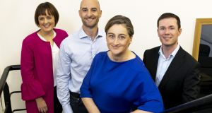 AQMetrics founder Geraldine Gibson (centre) with her management team. Photograph: Iain White/Fennell Photography.