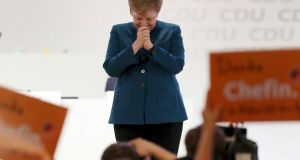 German chancellor and chairwoman of the Christian Democratic Union (CDU) Angela Merkel is applauded after her farewell speech. Photograph: Christian Charisius/DPA via AP