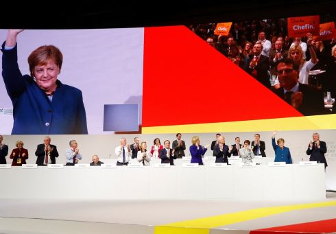 AUF WIEDERSEHEN: German chancellor Angela Merkel steps down as party leader at the CDU party congress in Hamburg. Photograph: Fabrizio Bensch/Reuters
