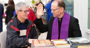 Bishop of Killaloe Fintan Monahan speaks to Des McDonald during Mercy on the Mall at Skycourt Shopping Centre in Shannon, Co Clare. Photograph: Liam Burke/Press 22