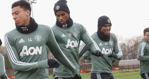Jesse Lingard, Marcus Rashford and Antonio Valencia of Manchester United in training. Photograph: John Peters/Man Utd via Getty Images