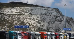 Cargo trucks wait to embark ferries in front of the white cliffs at the Port of Dover. Photograph: Luke MacGregor/Bloomberg via Getty Images