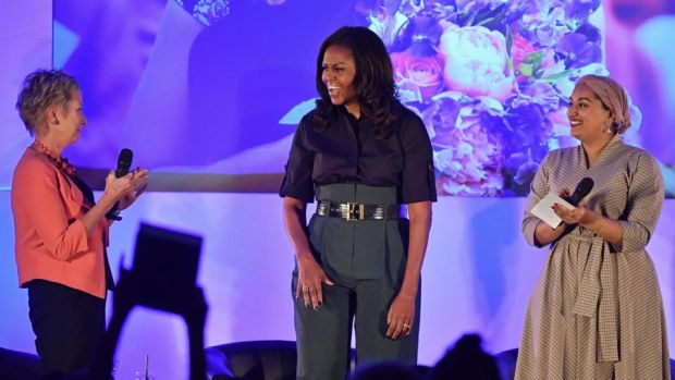 Former US first lady Michelle Obama on stage at Elizabeth Garrett Anderson School in London with executive headteacher Jo Dibb and girls' education activist Nusrath Hassan. Photograph: Ben Stansall/AFP/Getty Images