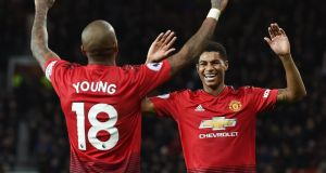 Manchester United's Marcus Rashford celebrates with Ashley Young during the Premier League win over Fulham. Photo: Phil Noble/Reuters