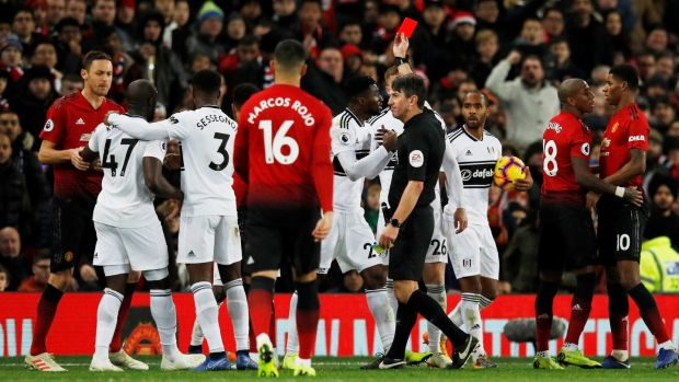 Fulham's Andre-Frank Zambo Anguissa is shown a red card by referee Lee Probert. Photo: Phil Noble/Reuters
