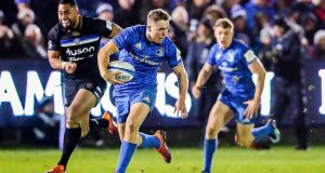 Jordan Larmour races clear to score Leinster's match-winning try against Bath. Photograph: Tommy Dickson/Inpho